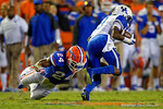 Florida Gators defensive back Brian Poole dives at the legs of Kentucky Wildcats wide receiver Demarco Robinson during the first half against the Kentucky Wildcats.  Florida Gators vs Kentucky Wildcats.  September 13th, 2014. Gator Country photo by David Bowie.