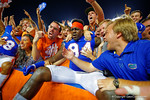 Florida Gators defensive lineman Bryan Cox, Jr. leaps into the stands and celebrates with the fans following their win in triple overtime versus the Kentucky Wildcats.  Florida Gators vs Kentucky Wildcats.  September 13th, 2014. Gator Country photo by David Bowie.