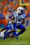 Kentucky Wildcats wide receiver Garrett Johnson cuts back across the field on a way to a touchdown on the first play of the first overtime versus the Florida Gators.  Florida Gators vs Kentucky Wildcats.  September 13th, 2014. Gator Country photo by David Bowie.