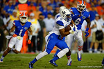 Kentucky Wildcats running back Braylon Heard rushes downfield being chased by Florida Gators defensive lineman Dante Fowler, Jr.  Florida Gators vs Kentucky Wildcats.  September 13th, 2014. Gator Country photo by David Bowie.