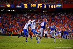 Kentucky Wildcats quarterback Patrick Towles throws toward the endzone during the second overtime versus the Florida Gators.  Florida Gators vs Kentucky Wildcats.  September 13th, 2014. Gator Country photo by David Bowie.