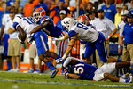 Florida Gators defensive back Marcus Maye makes the tackle on Kentucky Wildcats safety Glenn Faulkner during the second half.  Florida Gators vs Kentucky Wildcats.  September 13th, 2014. Gator Country photo by David Bowie.