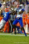 Florida Gators defensive back Jabari Gorman tries to break up the reception by Kentucky Wildcats receiver Ryan Timmons during the first half against the Kentucky Wildcats.  Florida Gators vs Kentucky Wildcats.  September 13th, 2014. Gator Country photo by David Bowie.