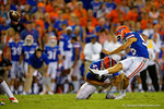 Florida Gators kicker Francisco Velez kicks in the first points of the game to put the Gators up 3-0 in the first half.  Florida Gators vs Kentucky Wildcats.  September 13th, 2014. Gator Country photo by David Bowie.