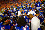 The Florida Gators take a knee and pray at midfield following their win in triple overtime versus the Kentucky Wildcats.  Florida Gators vs Kentucky Wildcats.  September 13th, 2014. Gator Country photo by David Bowie.