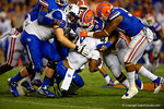 Florida Gators defensive lineman Caleb Brantley and Florida Gators defensive lineman Jonathan Bullard combine for the tackle on Kentucky Wildcats running back Braylon Heard in the first half.  Florida Gators vs Kentucky Wildcats.  September 13th, 2014. Gator Country photo by David Bowie.