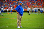 Florida Gators offensive coordinator Kurt Roper watches on as his offense warms up prior to the start of the game.  Florida Gators vs Kentucky Wildcats.  September 13th, 2014. Gator Country photo by David Bowie.