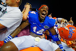 Florida Gators defensive lineman Alex McCalister leaps into the stands and celebrates with the fans following their win in triple overtime versus the Kentucky Wildcats.  Florida Gators vs Kentucky Wildcats.  September 13th, 2014. Gator Country photo by David Bowie.