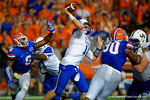Kentucky Wildcats quarterback Patrick Towles throws downfield late in the fourth quarter as Florida Gators defensive lineman Dante Fowler, Jr. rushes in.  Florida Gators vs Kentucky Wildcats.  September 13th, 2014. Gator Country photo by David Bowie.