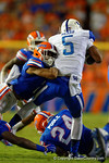 Florida Gators defensive back Vernon Hargreaves, III makes a diving tackle on Kentucky Wildcats running back Braylon Heard during the first half against the Kentucky Wildcats.  Florida Gators vs Kentucky Wildcats.  September 13th, 2014. Gator Country photo by David Bowie.