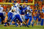 Florida Gators defensive lineman Dante Fowler, Jr. rushes upfield towards Kentucky Wildcats quarterback Patrick Towles during the first half.  Florida Gators vs Kentucky Wildcats.  September 13th, 2014. Gator Country photo by David Bowie.