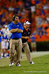 Florida Gators Head Coach Will Muschamp and Florida Gators offensive line coach Mike Summers watch on from the sideline during overtime.  Florida Gators vs Kentucky Wildcats.  September 13th, 2014. Gator Country photo by David Bowie.