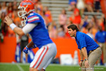 Florida Gators Head Coach Will Muschamp watches on as his team prepares before the start of the game against the Kentucky Wildcats.  Florida Gators vs Kentucky Wildcats.  September 13th, 2014. Gator Country photo by David Bowie.