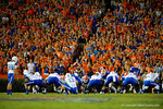 The Florida Gators crowd yells and waves their arms in an attempt to distract Kentucky Wildcats kicker Austin MacGinnis during the first half.  Florida Gators vs Kentucky Wildcats.  September 13th, 2014. Gator Country photo by David Bowie.