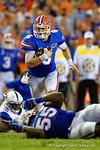 Florida Gators quarterback Jeff Driskel scrambles downfield during the first half against the Kentucky Wildcats.  Florida Gators vs Kentucky Wildcats.  September 13th, 2014. Gator Country photo by David Bowie.