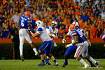 Kentucky Wildcats quarterback Patrick Towles has his pass defended by Florida Gators defensive lineman Dante Fowler, Jr. in the fourth quarter.  Florida Gators vs Kentucky Wildcats.  September 13th, 2014. Gator Country photo by David Bowie.