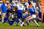 Florida Gators tight end Tevin Westbrook makes the catch in the fourth quarter and is immediately tackled by the Kentucky Wildcat defense.  Florida Gators vs Kentucky Wildcats.  September 13th, 2014. Gator Country photo by David Bowie.