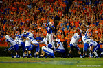 Florida Gators defensive lineman Dante Fowler, Jr. leaps into the air attempting to block the field goal attempt of Kentucky Wildcats kicker Austin MacGinnis in the first half.  Florida Gators vs Kentucky Wildcats.  September 13th, 2014. Gator Country photo by David Bowie.