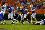 Florida Gators running back Matt Jones attempts to break from of the tackle by the Kentucky defenseman in first half.  Florida Gators vs Kentucky Wildcats.  September 13th, 2014. Gator Country photo by David Bowie.