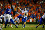 Kentucky Wildcats quarterback Patrick Towles is hit by Florida Gators defensive lineman Dante Fowler, Jr. disrupting the pass on second down during the second overtime.  Florida Gators vs Kentucky Wildcats.  September 13th, 2014. Gator Country photo by David Bowie.