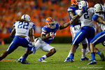 Florida Gators running back Kelvin Taylor tries to cut back to avoid the tackle by Kentucky Wildcats linebacker Khalid Henderson during the second half.  Florida Gators vs Kentucky Wildcats.  September 13th, 2014. Gator Country photo by David Bowie.