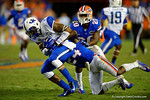 Kentucky Wildcats wide receiver Dorian Baker is tackled by Florida Gators defensive back Brian Poole in the fourth quarter.  Florida Gators vs Kentucky Wildcats.  September 13th, 2014. Gator Country photo by David Bowie.