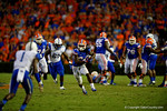 Florida Gators running back Matt Jones rushes downfield late in the fourth quarter trying to get the Gators in field goal position.  Florida Gators vs Kentucky Wildcats.  September 13th, 2014. Gator Country photo by David Bowie.
