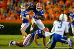 Florida Gators running back Matt Jones hurdles over Florida Gators tight end Clay Burton on his way to a first down during the first half against the Kentucky Wildcats.  Florida Gators vs Kentucky Wildcats.  September 13th, 2014. Gator Country photo by David Bowie.