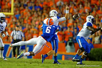 Florida Gators defensive lineman Dante Fowler, Jr. makes the hit on Kentucky Wildcats quarterback Patrick Towles knocking the ball loose during the first half.  Florida Gators vs Kentucky Wildcats.  September 13th, 2014. Gator Country photo by David Bowie.