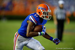 Florida Gators wide receiver Demarcus Robinson makes the reception and sprints downfield  during the second half against the Kentucky Wildcats. Florida Gators vs Kentucky Wildcats.  September 13th, 2014. Gator Country photo by David Bowie.
