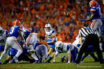 Kentucky Wildcats kicker Austin MacGinnis kicks in a 51 yard field goal to tie the game against the Florida Gators at 20-20 late in the fourth quarter.  Florida Gators vs Kentucky Wildcats.  September 13th, 2014. Gator Country photo by David Bowie.