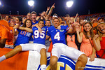 Florida Gators kickers Francisco Velez and Kyle Christy leaps into the stands and celebrates with the fans following their win in triple overtime versus the Kentucky Wildcats.  Florida Gators vs Kentucky Wildcats.  September 13th, 2014. Gator Country photo by David Bowie.