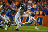Florida Gators quarterback Jeff Driskel scrambles to his left looking downfield during the first quarter.  Florida Gators vs Missouri Tigers.  October 18th, 2014. Gator Country photo by David Bowie.