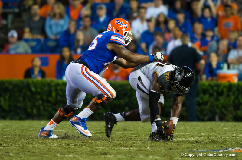 Missouri Tigers defensive lineman Markus Golden picks up a fumble and returns it into the endzone during the third quarter.  Florida Gators vs Missouri Tigers.  October 18th, 2014. Gator Country photo by David Bowie.