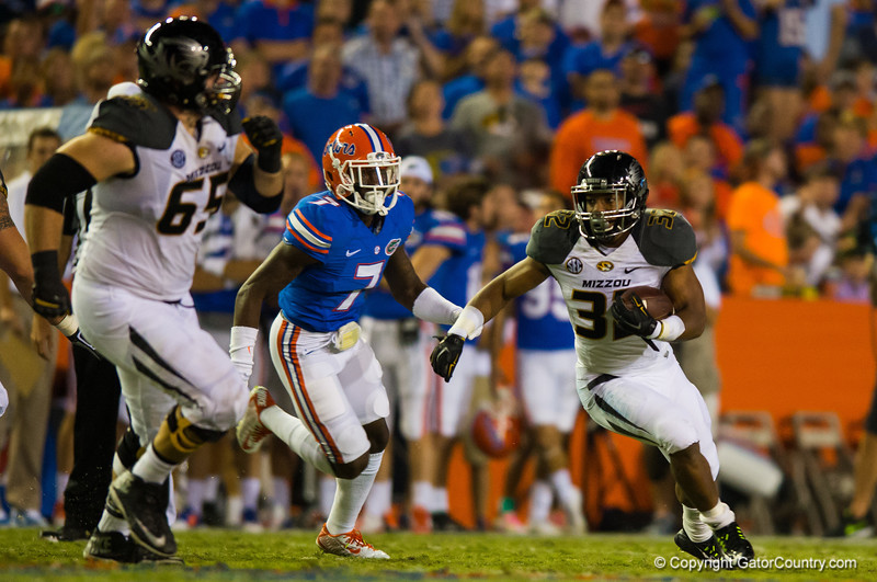 Missouri Tigers tailback Russell Hansbrough rushes downfield as Florida Gators safety Duke Dawson sprints to catch him.  Florida Gators vs Missouri Tigers.  October 18th, 2014. Gator Country photo by David Bowie.