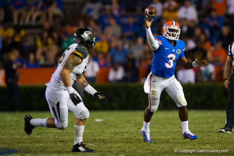 Florida Gators quarterback Treon Harris throwing on the run during the fourth quarter.  Florida Gators vs Missouri Tigers.  October 18th, 2014. Gator Country photo by David Bowie.