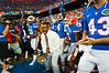Former Florida Gator Lito Sheppard, the honorary Mr. 2-Bits, leads the Gators onto the field.  Florida Gators vs Missouri Tigers.  October 18th, 2014. Gator Country photo by David Bowie.