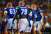 Florida Gators quarterback Jeff Driskel has some words with Florida Gators running back Matt Jones after Jones fumbled the ball in the second quarter.  Florida Gators vs Missouri Tigers.  October 18th, 2014. Gator Country photo by David Bowie.