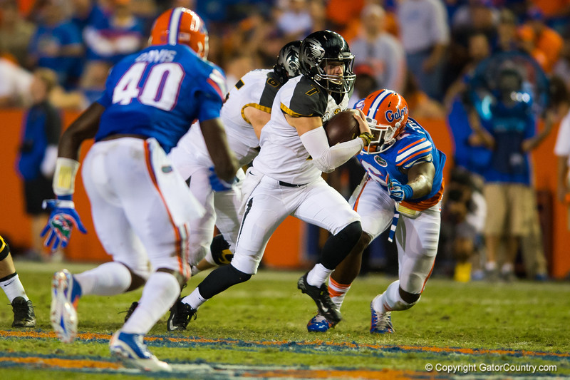 Missouri Tigers quarterback Maty Mauk keeps the ball and rushes for a first down during the first quarter.  Florida Gators vs Missouri Tigers.  October 18th, 2014. Gator Country photo by David Bowie.