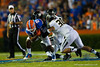 Florida Gators running back Kelvin Taylor is tackled by the Missouri defense.  Florida Gators vs Missouri Tigers.  October 18th, 2014. Gator Country photo by David Bowie.