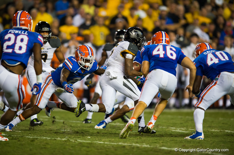 Florida Gators defensive back Jabari Gorman dives but misses his tackle as Missouri Tigers tailback Marcus Murphy runs back his second kickoff return off the day.   Florida Gators vs Missouri Tigers.  October 18th, 2014. Gator Country photo by David Bowie.