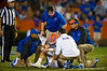 Florida Gators Head Coach Will Muschamp comes out to check as the Florida medical staff checks on Florida Gators quarterback Jeff Driskel.  Florida Gators vs Missouri Tigers.  October 18th, 2014. Gator Country photo by David Bowie.