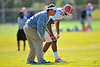 Gator head coach Will Muschamp works with DB Evan Schroeder during practice.  Florida Gators Spring Practice 2014.  March 26st, 2014.  Gator Country photo by David Bowie.