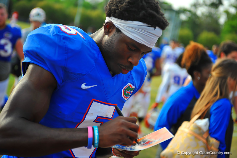 Gator WR Ahmad Fulwood signs an autograph for a Gator fan.  Florida Gators Spring Practice 2014.  March 26st, 2014.  Gator Country photo by David Bowie.