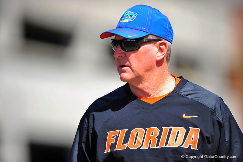 Gator offensive line coach Mike Summers walks into spring practice.  Florida Gators Spring Practice 2014.  March 26st, 2014.  Gator Country photo by David Bowie.