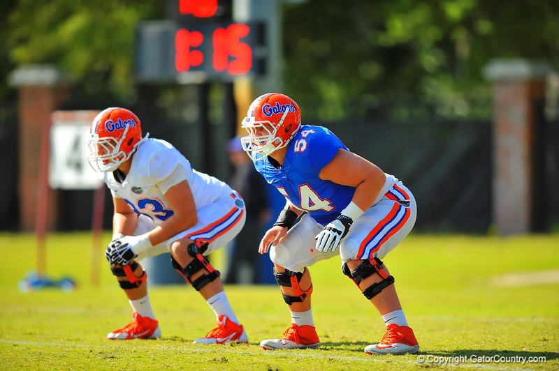 OL Cameron Dillard get ready for their practice drill.  Florida Gators Spring Practice 2014.  March 26st, 2014.  Gator Country photo by David Bowie.