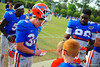 The Gator football players end practice and walk over to the Gator fans watching practice to sign autographs.  Florida Gators Spring Practice 2014.  March 26st, 2014.  Gator Country photo by David Bowie.