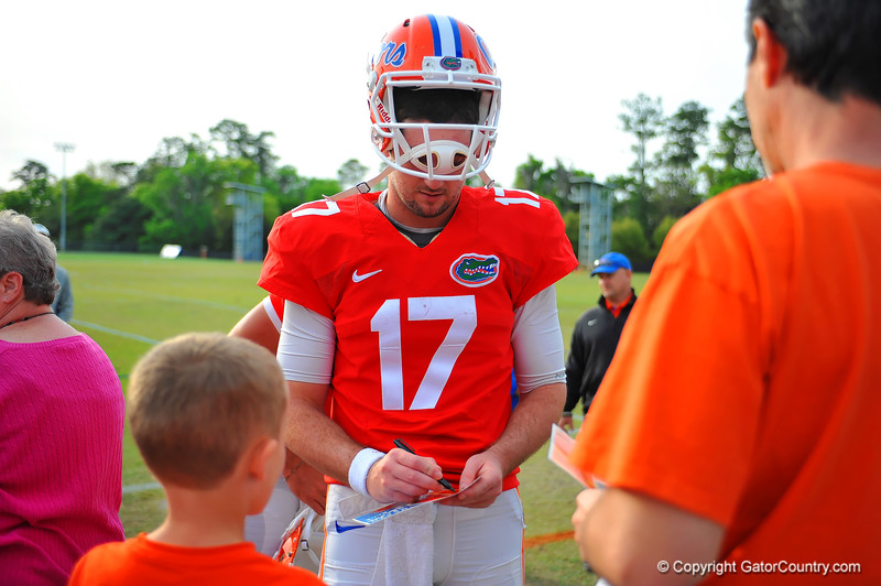 QB Skyler Mornhinweg signs autographs for the fans after practice.  Florida Gators Spring Practice 2014.  March 26st, 2014.  Gator Country photo by David Bowie.