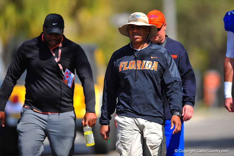 Gator wide receivers coach Joker Phillips makes his way to the Gator practice field.  Florida Gators Spring Practice 2014.  March 26st, 2014.  Gator Country photo by David Bowie.