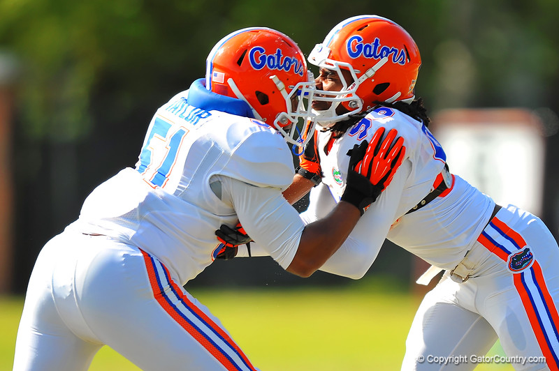 Gators LB Michael Taylor and DL Sterling Stanley run a blocking drill during practice.  Florida Gators Spring Practice 2014.  March 26st, 2014.  Gator Country photo by David Bowie.